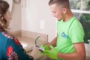 man working on plumbing